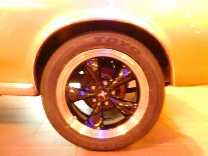 Lime gold green Ford Mustang 1967 coupe tire closeup #705